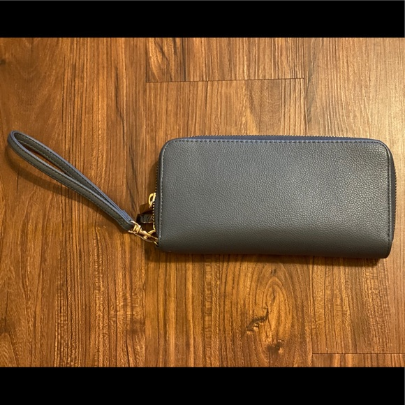 None Handbags - Blue wallet. New